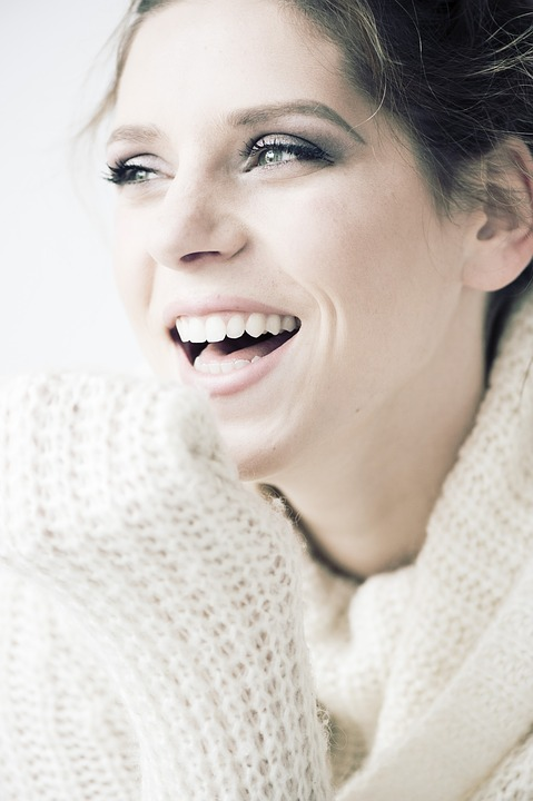 young female patient with perfect teeth laughing